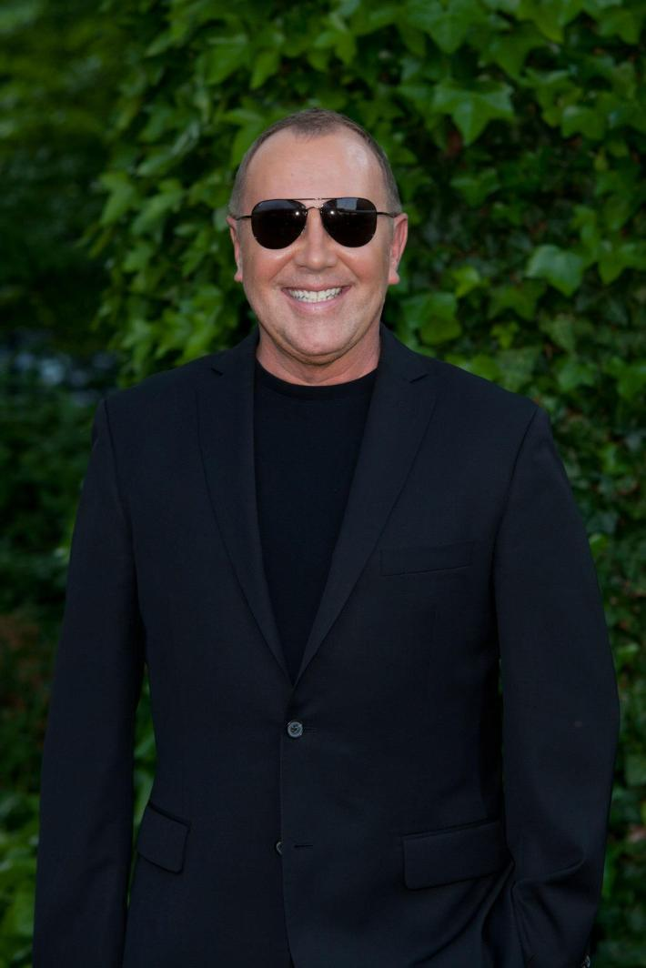 Designer Michael Kors pose for a picture during the 12th Annual Bette Midler's New York Restoration Project Spring Picnic  (Photo by Yoni Levy)