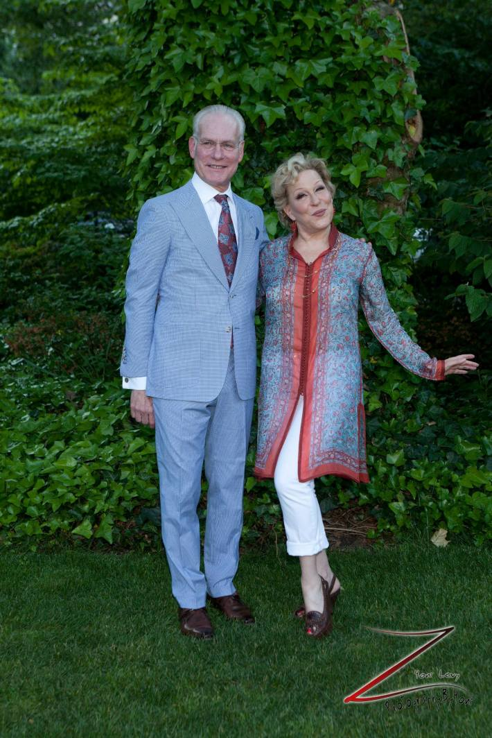TV personality Tim Gunn and Bette Midler pose for a picture during the 12th Annual Bette Midler's New York Restoration Project Spring Picnic  (Photo by Yoni Levy)