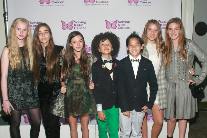 Claire Greenburger, Celia Babini, Rose Marjos, DJ Fulano Librizzo, Kyah Cahill, Amber Pongrass and  Siena Harris attend the fifth annual Solving Kids' Cancer Spring Celebration at 583 Park Avenue
