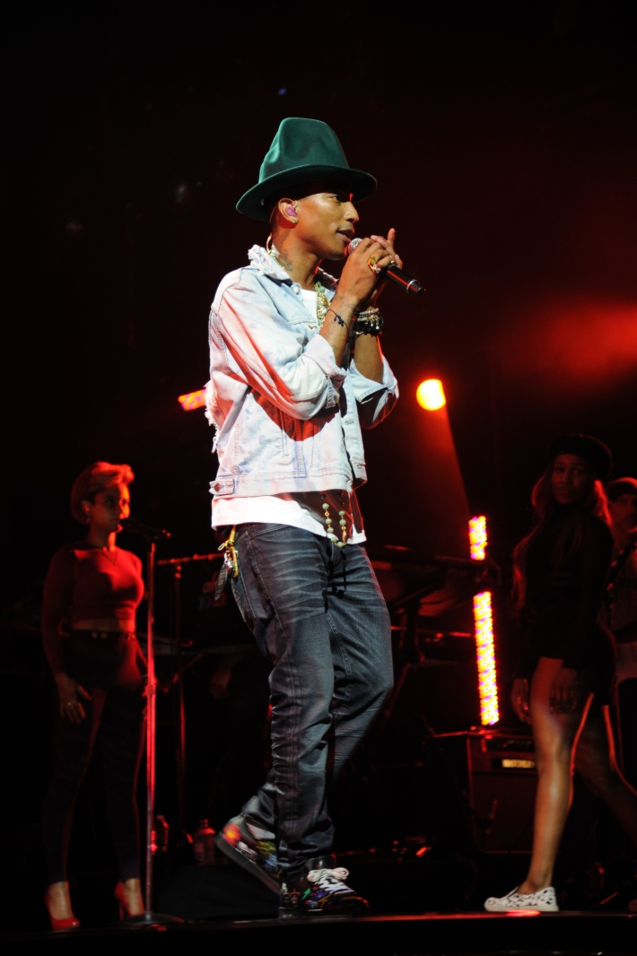 "Pharrell performs for the ""American Express Unstaged"" music series, directed by Spike Lee, from Apollo Theatre. (Photo by Bryan Bedder/Getty Images)"