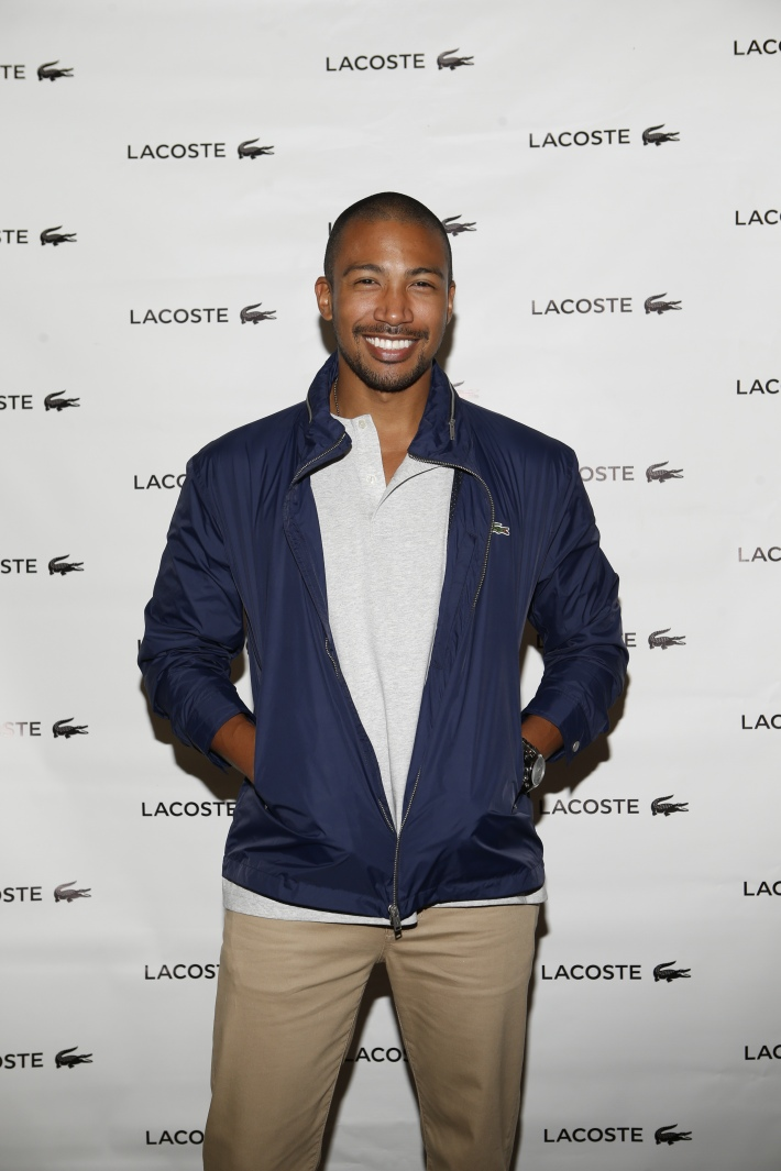 Charles Michael Davis backstage at the Lacoste fashion show during Mercedes-Benz Fashion Week Spring 2015 (Photo by Yannis Vlamos)