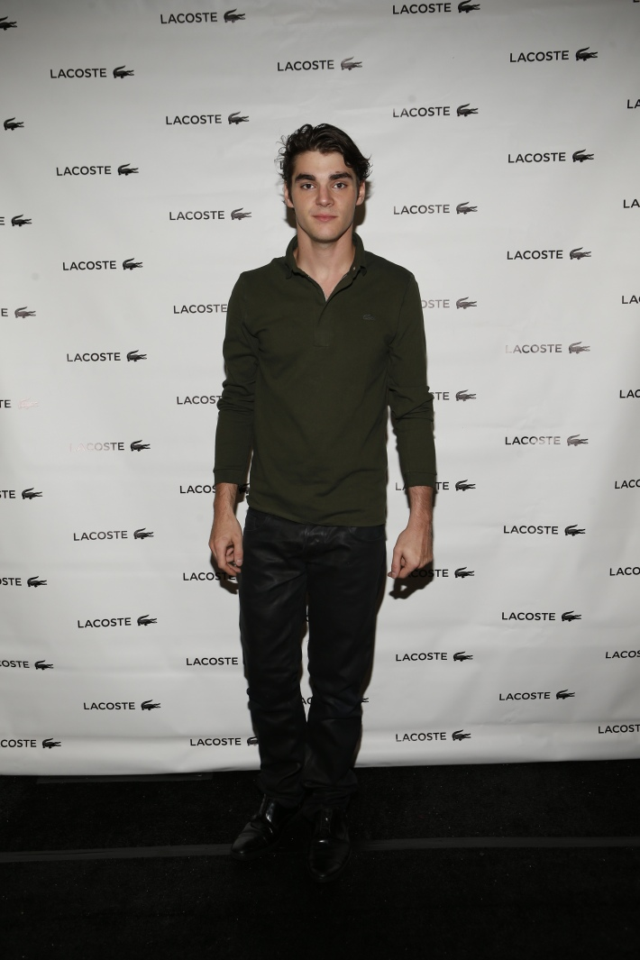 RJ Mitte backstage at the Lacoste fashion show during Mercedes-Benz Fashion Week Spring 2015 (Photo by Yannis Vlamos)