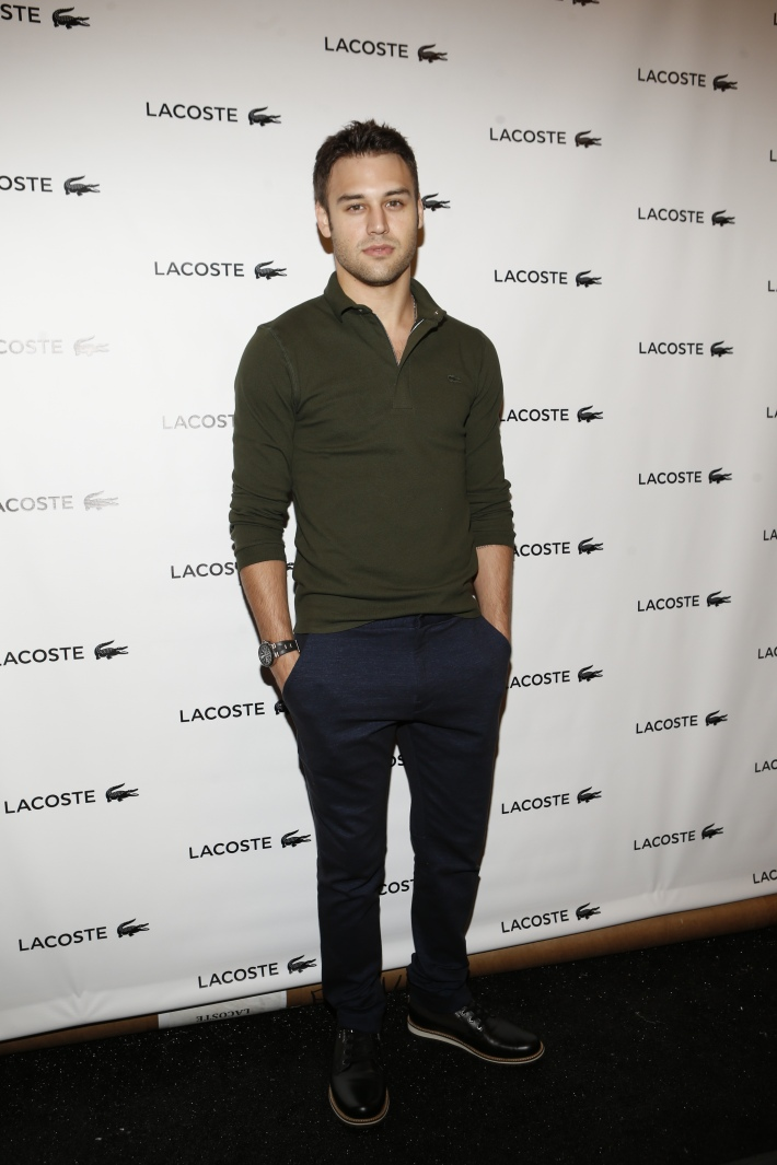 Ryan Guzman backstage at the Lacoste fashion show during Mercedes-Benz Fashion Week Spring 2015 (Photo by Yannis Vlamos)