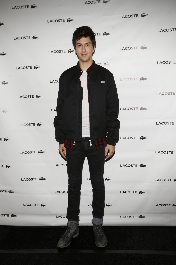 Nat Wolff backstage at the Lacoste fashion show during Mercedes-Benz Fashion Week Spring 2015 (Photo by Yannis Vlamos)