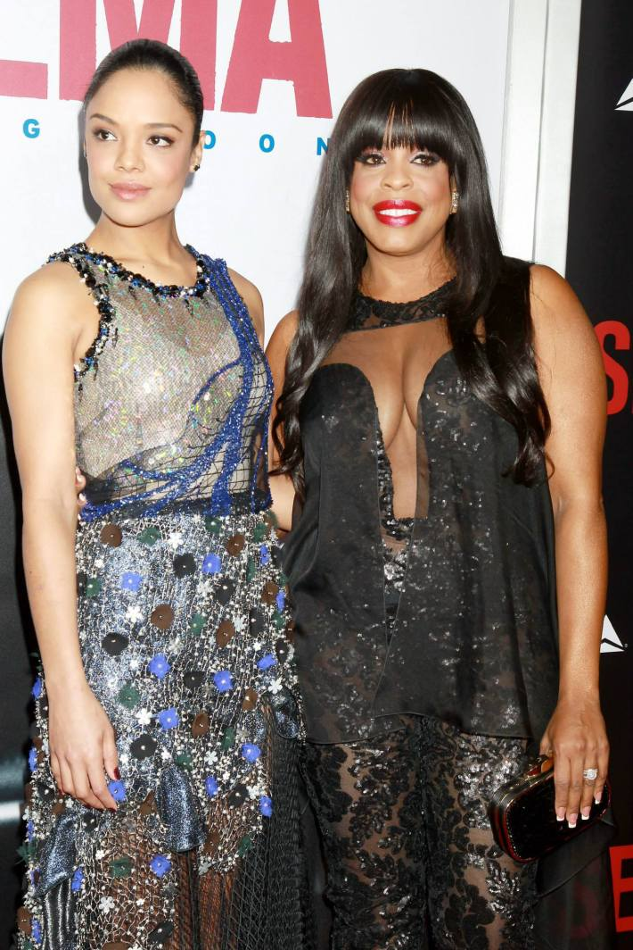 Actors Tessa Thompson and Niecy Nash attend the 'Selma' New York Premiere at the Ziegfeld Theater