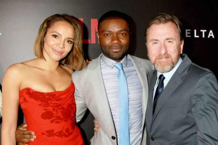 Actors Carmen Ejogo, David Oyelowo and Tim Roth attend the 'Selma' New York Premiere at the Ziegfeld Theater