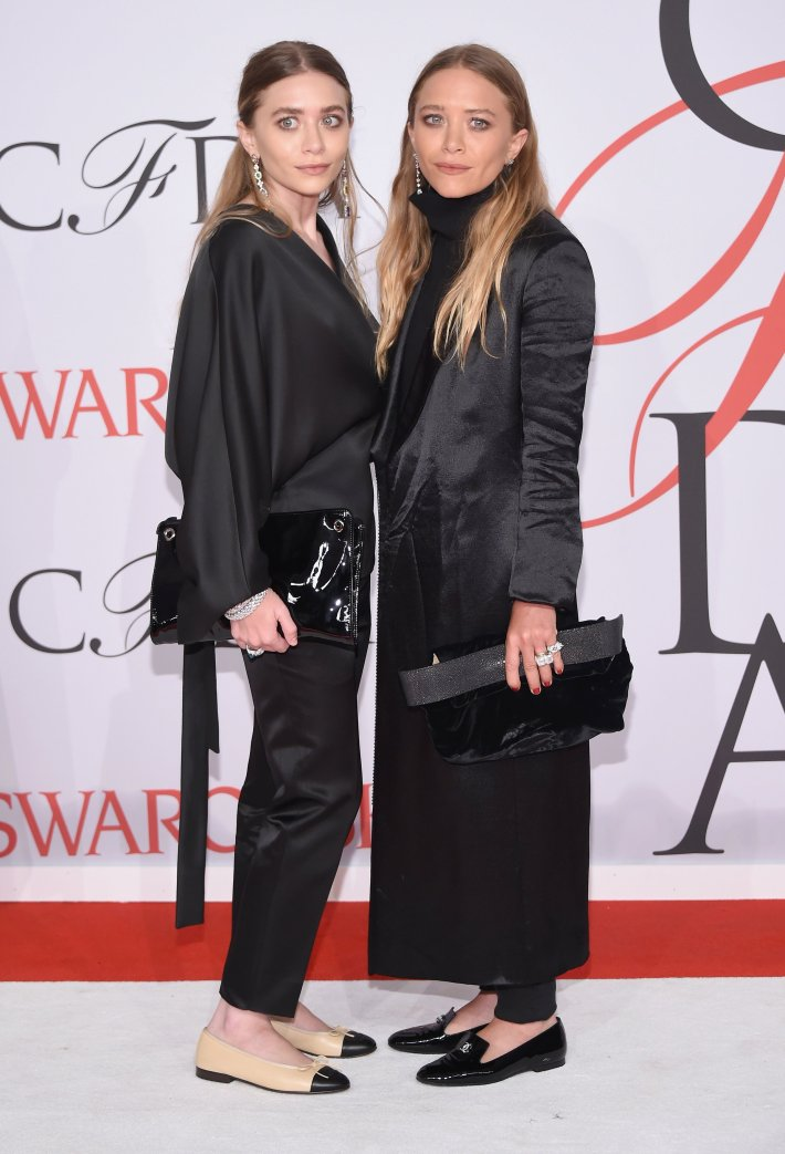 Mary-Kate Olsen and Ashley Olsen attends the 2015 CFDA Fashion Awards at Alice Tully Hall at Lincoln Center