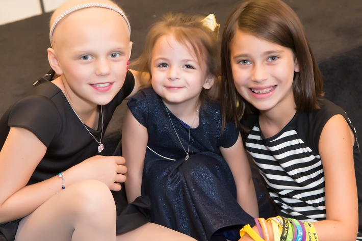 Tessa Prothero, Delaney Kurdyla, and friend attend RUNWAY HEROES Fashion Show Hosted by Bloomingdale's 59th Street featuring Childhood Cancer Fighters & Survivors