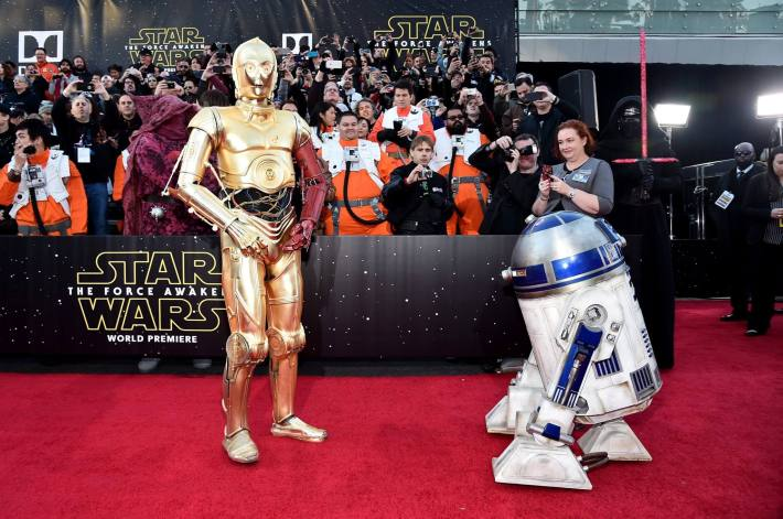 R2-D2 (L) and C-3PO attend the World Premiere of Star Wars: The Force Awakens!